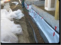 Exterior Perimeter Drain Under Construction