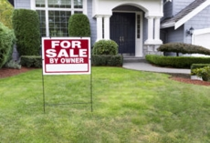 """For sale"" sign in yard"
