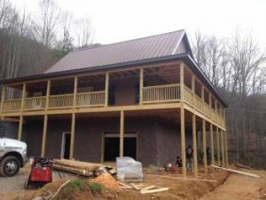 Large house in wooded area being built