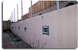 Tieback plates on retaining wall