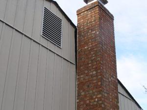 Leaning brick chimney in Houston