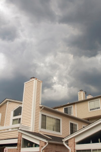 Storm clouds behind houses