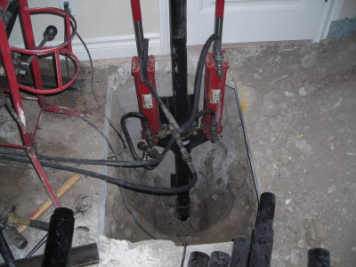Machine drilling into foundation