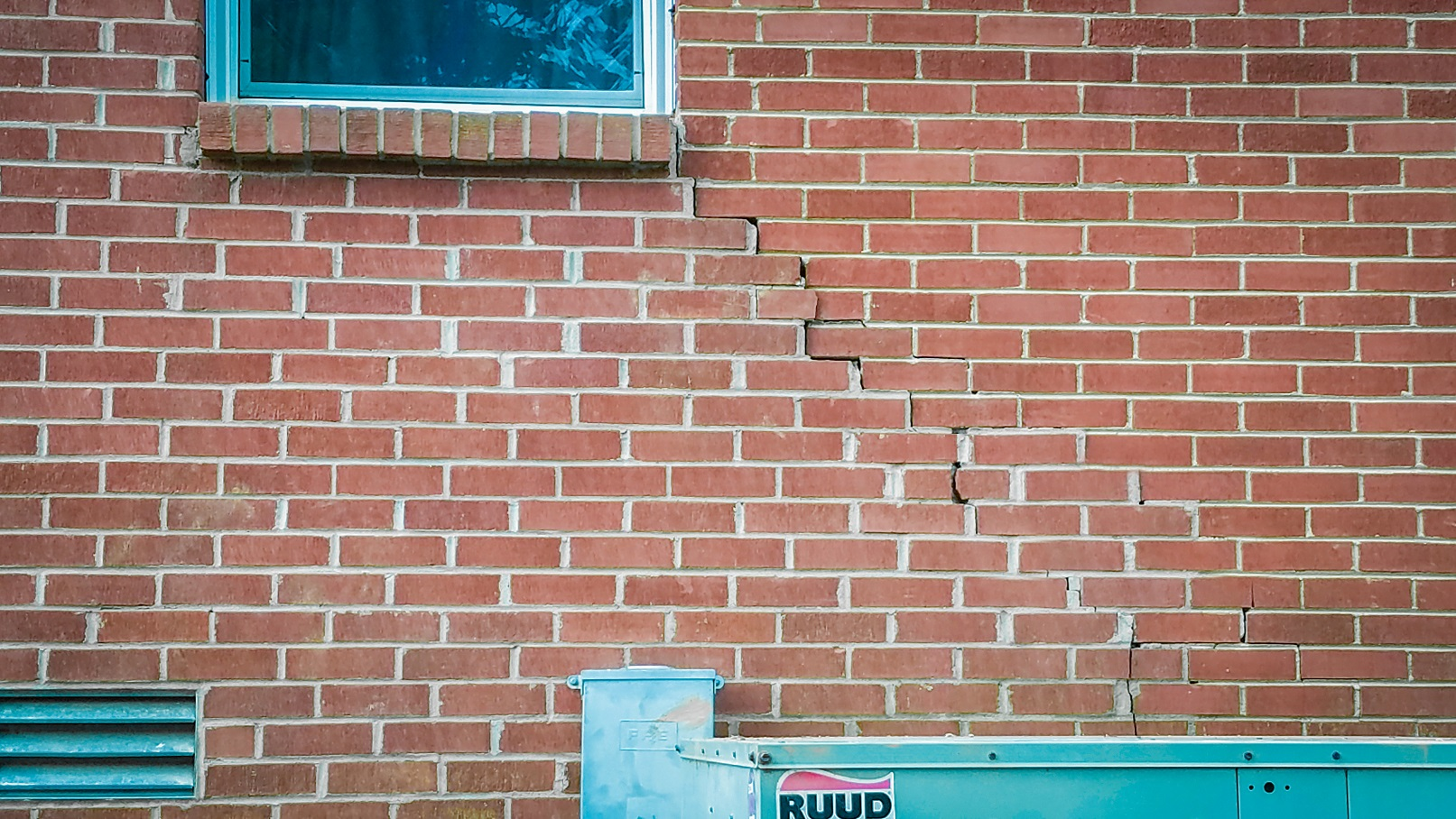 crack in brickwork of a home